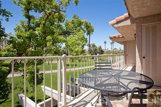 main deck and 16th hole - BEST LOCATION, BEAUTIFUL MESQUITE GOLF CONDO - Palm Springs - rentals