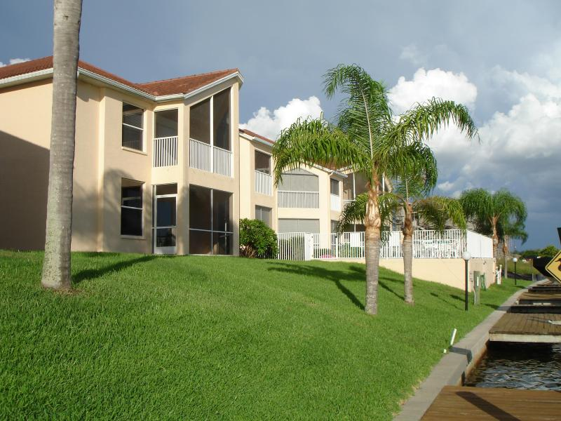 view from canal,unit is on lower left - BEST DEAL ON THE CAPE,LOCATED ON WIDE CANAL - Cape Coral - rentals