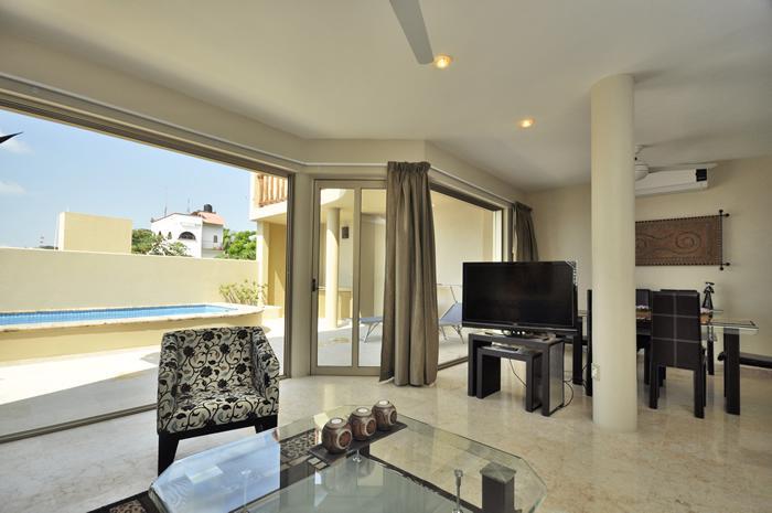 Spacious open living with entire wall opening to rear court yard. - Casa Marea Solar Puerto Vallarta - Puerto Vallarta - rentals