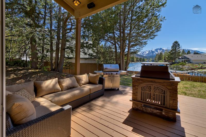 Take in the natural beauty surrounding you while warming up by the fire pit and lounging on the comfy outdoor furniture. - Waterfront home with private boat dock, hot tub and mountain views - Luxury Tahoe Keys Home - South Lake Tahoe - rentals