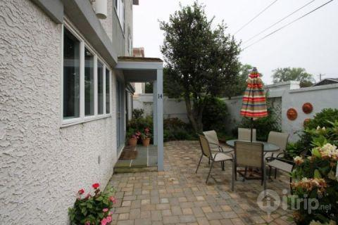 20 Sea Gate Front Entrance with Patio. Enjoy the ocean block private beach and two pools. - Ocean Block 4BR Condo w/Two Pools! - Dewey Beach - rentals