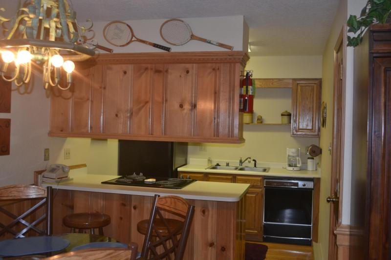 Complete kitchen with stove/oven, dishwasher, refrigerator/freezer & pots/pans, utensils & dishes - Angel Fire, NM - Snow Fire Condo - Angel Fire - rentals