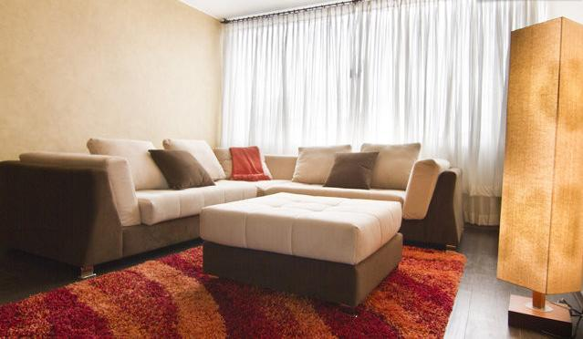 Spacious living room with sectional couch - Modern Luxury l Center of Quito - Quito - rentals