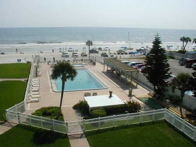 Pool and  Ocean view from the balcony - New Smyrna Beach, Oceanfront condo, 2 bed 2 bath, - New Smyrna Beach - rentals