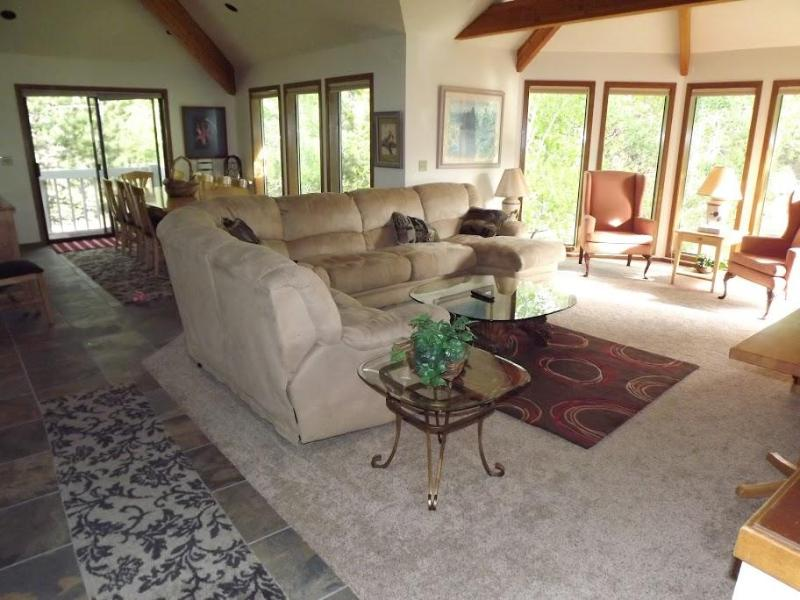 View from the top of the stairs - lots of light from floor to ceiling windows comfortable seating - Sunriver Home 3500 sq ft 4 suites 4th Night Free! - Sunriver - rentals