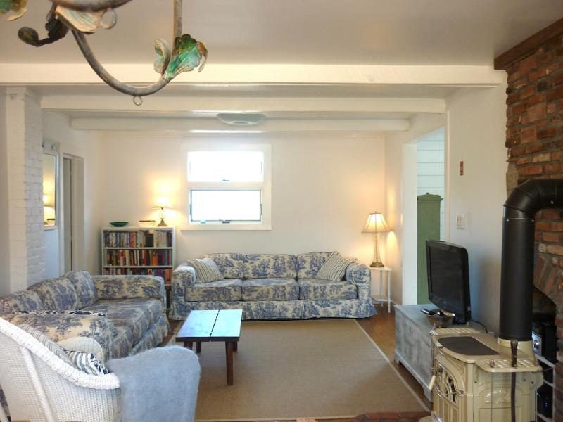 Living room - one of many of places to relax throughout the house - Lovely Peaceful Getaway–Stroll to Beach + Village! - Oak Bluffs - rentals
