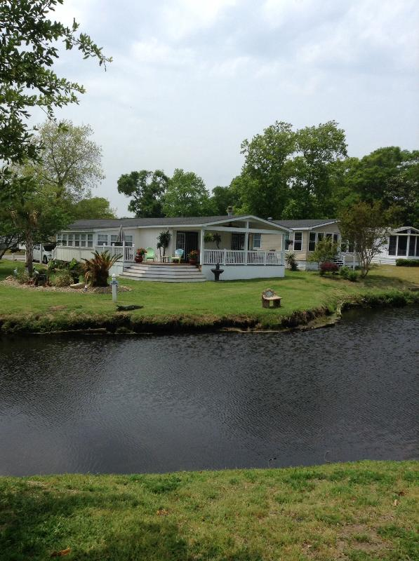 Front of house from across the lake - Our dream at the beach-Newly Renovated - Surfside Beach - rentals