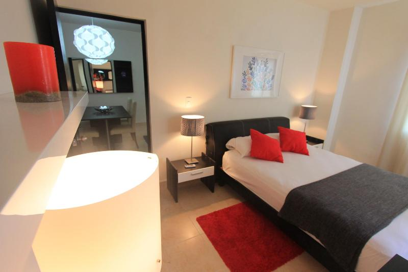Master bedroom with queen bed & mini split and nice view - All Furnished Condo Playa del Carmen Caleta 2 - Playa del Carmen - rentals
