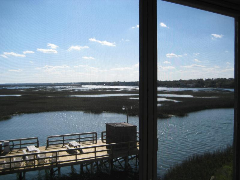 View of the inlet from porch at high tide - Inlet view and only a few steps to the beach! - Garden City Beach - rentals