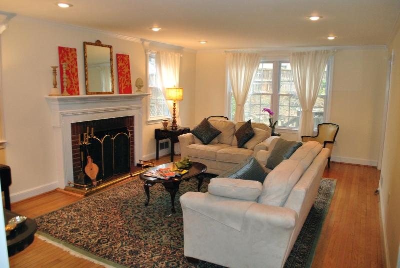 Spacious living room with 2 large sofas and a wonderful fireplace - American University ~ walk to Metro ~ deck & yard! - Washington DC - rentals