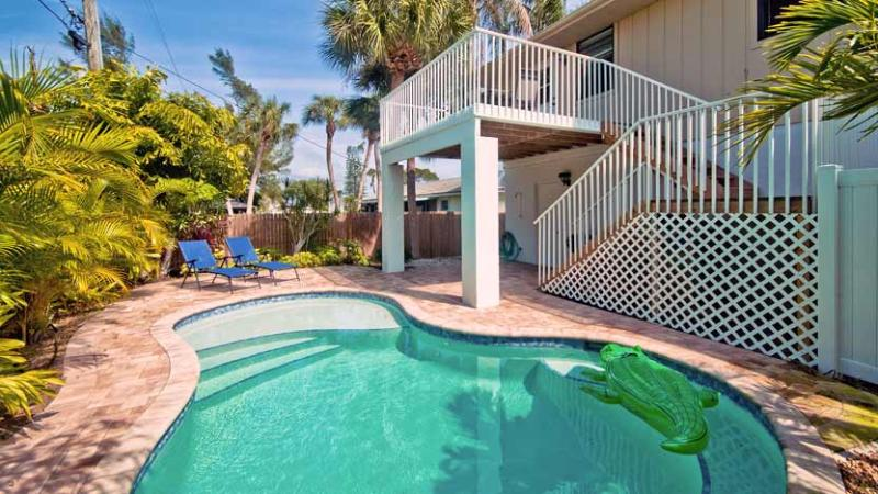 Backyard - Island Hideaway East: 2BR Kid-Friendly Pool Home - Holmes Beach - rentals