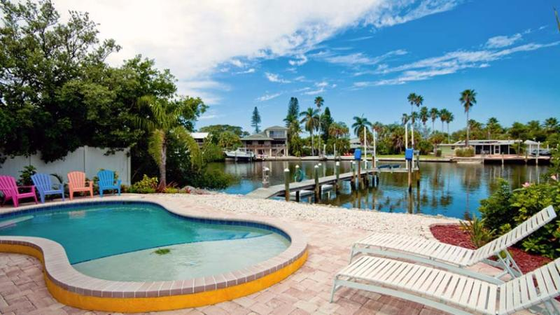 Pool with a Canal View - Starfish Dreams: 2BR Canal Home w/Dock and Pool - Anna Maria - rentals