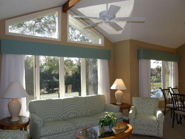 Living, Dining areas overlooking large lagoon - Luxury, private, walk to beach condominium - Hilton Head - rentals