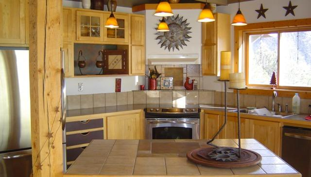 The gourmet kitchen has stainless appliances, an island, a walk-in pantry & a window over the sink. - ROCK ON AT HIGH COUNTRY HEAVEN - DOGS & KIDS OK! - Salida - rentals