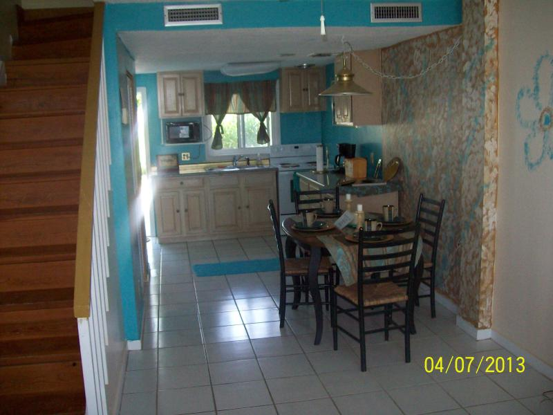 View of dinning room & kitchen from front room - Canal Front Condo - Treasure Cay - rentals
