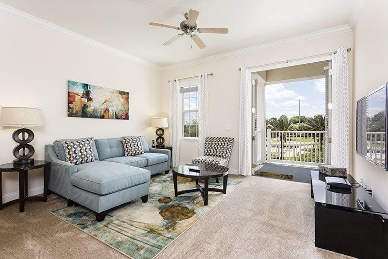 Living area with pull-out sofa bed, 55 in 3D Plasma TV - Pool View - Reunion Terraces Condo Overlooking Pool - Just 6 Miles from Disney - Reunion - rentals