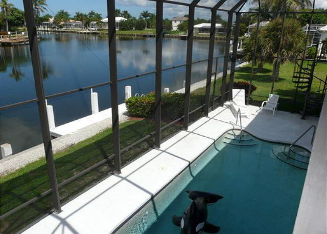 View of Pool from Balcony - Florida-style home w/ heated pool & mesmerizing water views - Marco Island - rentals