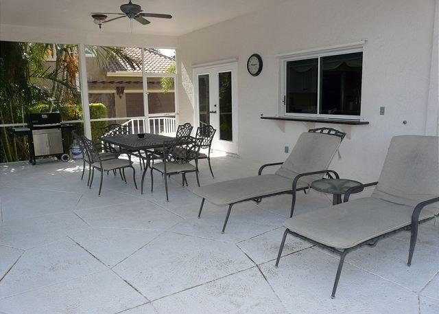 Patio - Two-story, waterfront house w/ heated pool & short walk to Resident's Beach - Marco Island - rentals