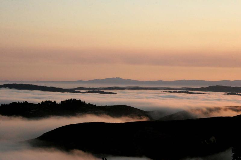 Above the fog sunsets, never get tired of seeing this. - Time Honored Adobe Home - Sweeping Ocean View on 12 Acres. - Carmel - rentals