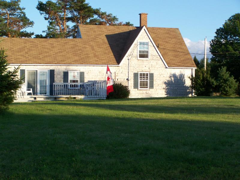 House sits on a hill overlooking Harbour - CLASSIC MARITIME  COTTAGE  with  WATERVIEW  conveniently located btwn BEACH and TOWN - New Glasgow - rentals