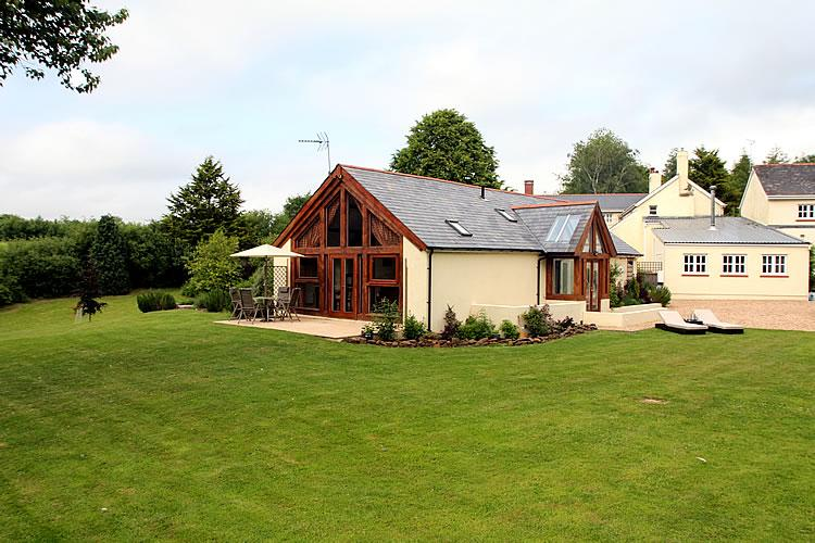 Exterior picture of The Dairy –  The Dairy sleeps 4 to 6  plus a cot, with private patio area - The Dairy - Luxury 5 star Self-Catering Cottage - Crediton - rentals