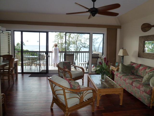 Living Room Looking Toward the Lanai - Quiet and Private Oceanfront Condo - Kapaa - rentals