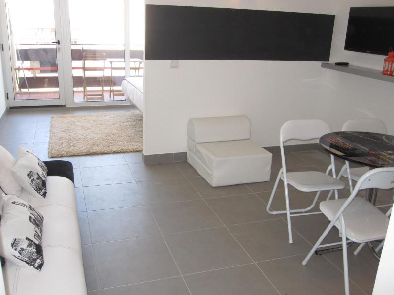 view of the living room leading to bedroom and balcony - Affordable Luxury Condo in Prime Vilamoura Location - Algarve - rentals