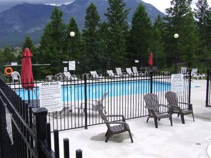Outdoor heated pool, outdoor hot tub and indoor hot tub - Modern, Spacious & Mountain Views Radium Condo - Radium Hot Springs - rentals