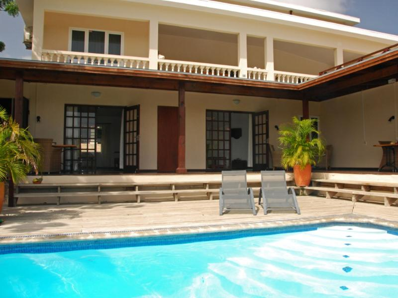 View from our pool at apartment 2 (right door) - Curavilla | Luxurious double apartment with pool, #2 - Willemstad - rentals