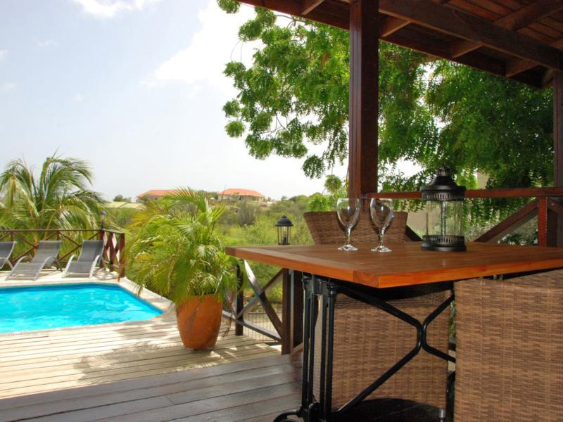 View from apartment 1 overlooking our pool - Curavilla | Luxurious double apartment with pool, #1 - Willemstad - rentals