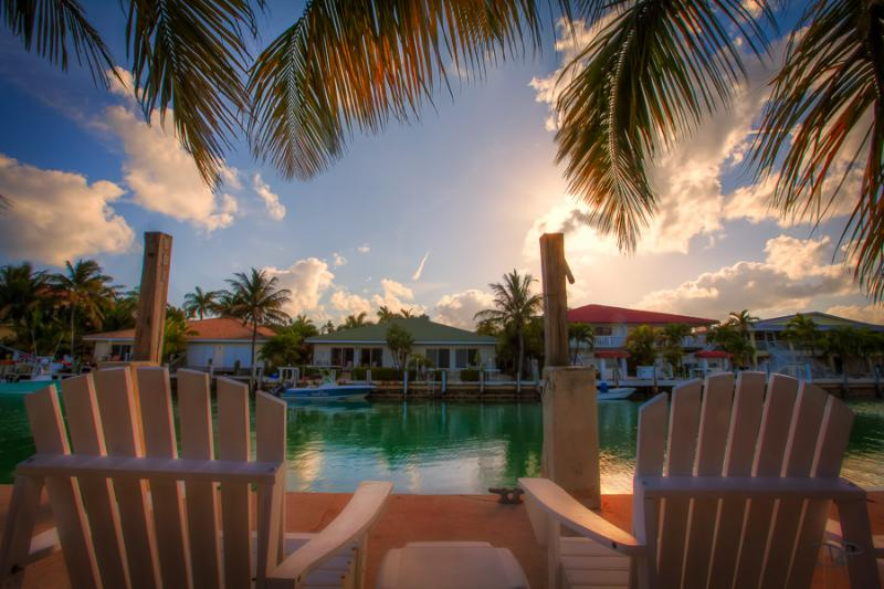 Sit on the dock with a refreshing drink, drop in a line too! - KEYS ESCAPE SPECIAL! Bikes, Pool, 2 Beaches - Key Colony Beach - rentals