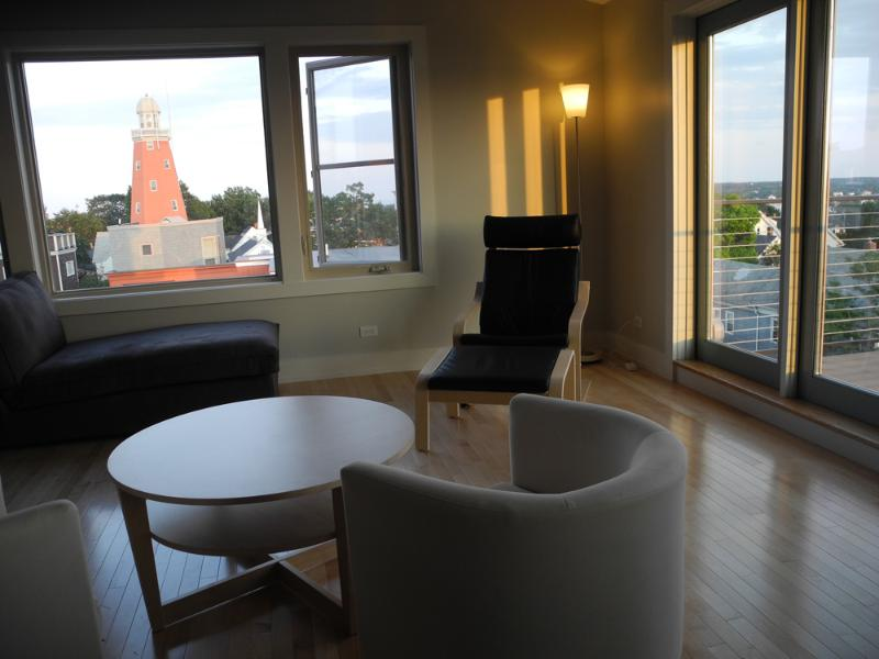 Open fourth floor lounging area, views of the Observatory and the ocean beyond. - Penthouse Apartment on Munjoy Hill -Amazing Views! - Portland - rentals