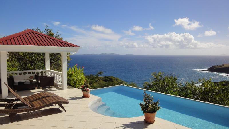 Pool deck, gazebo, and view to Mustique - Whispers Villa - Luxury, with stunning sea views - Bequia - rentals