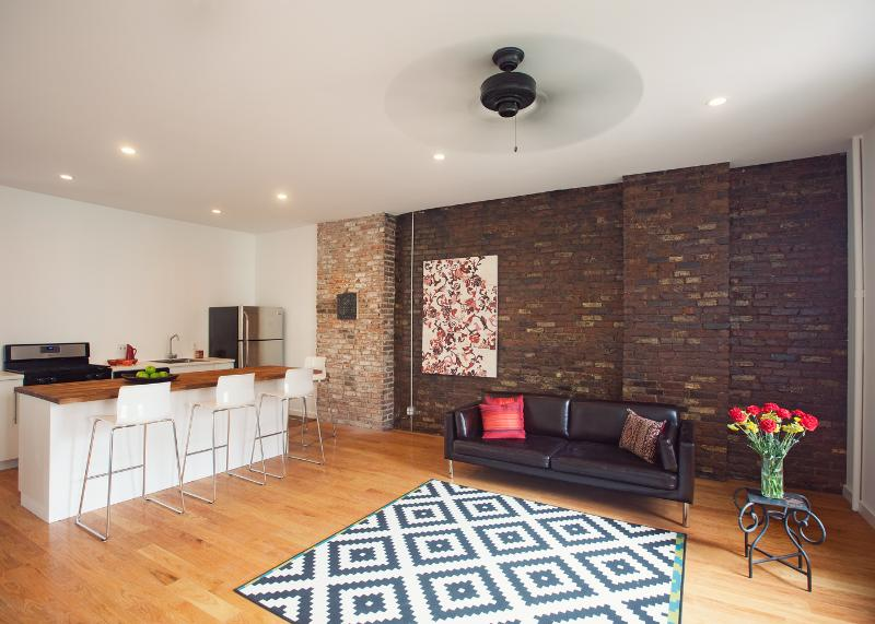 Living room/kitchen/dining area, exposed brick wall - Elegant Creative Class-Luxury Loft-5 min Times Squ - Long Island City - rentals