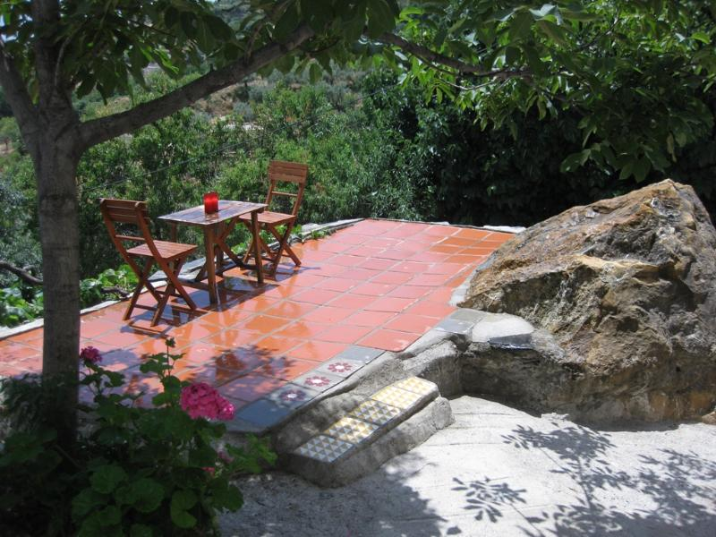 The private terrace built into the rock. - Rustic apartment in Las Alpujarras, Sierra Nevada. - Valor - rentals