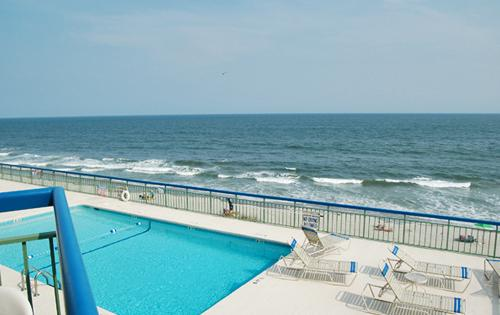 Your oceanfront balcony overlooks the 4th floor pool - Immaculate oceanfront 1BR, The Oceans, WiFi/pool - North Myrtle Beach - rentals
