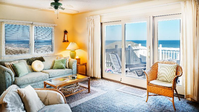Lounge - showing view out of windows - Captain's House Unit A3 Oceanfront - Fernandina Beach - rentals