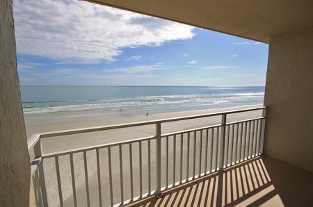 Balcony View - Sea Coast Gardens- Beautiful Oceanfront unit! - New Smyrna Beach - rentals
