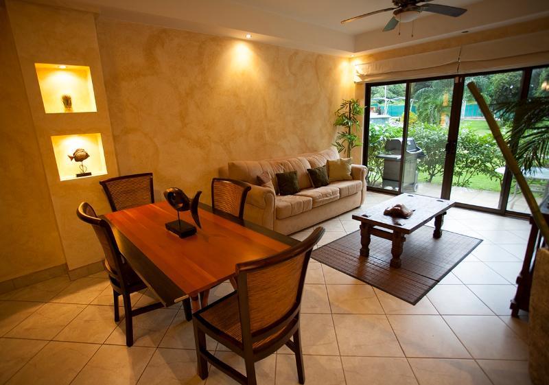 Living and dining area - The Oaks Tamarindo Condominium 82 Ground Floor BBQ - Tamarindo - rentals