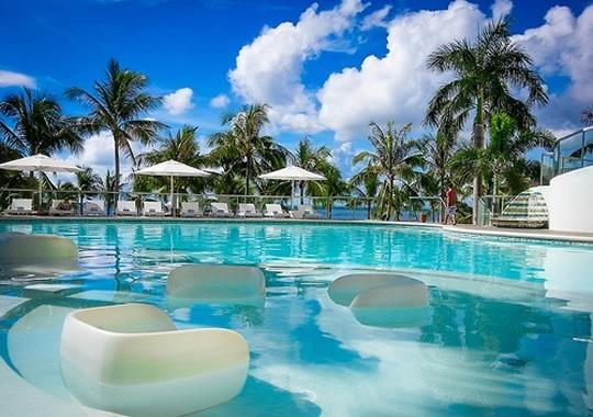 Modern Swimming Pool in the midst of Palm Trees and right by the Beach - MOVENPICK 1BR LUXURY OCEAN FRONT CONDO IN CEBU - Cebu - rentals