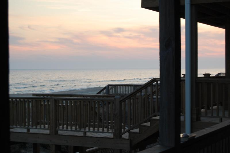 Looking out on the back patio at sunset - Holden Beach Oceanfront and Marshfront Stunner! - Holden Beach - rentals