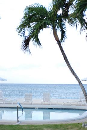 Lounging by the beachside Pool - Accommodates 2 Couples and 2 Children - Seven Mile Beach - rentals