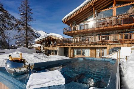 Sophisticated Chalet Le Chardon, ski in/out, fabulous sun terrace and hot tubs - Image 1 - Val-d'Isère - rentals