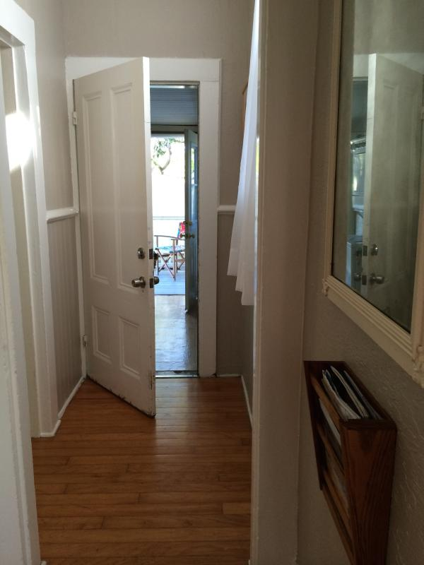 See Bathroom door on the left of this pic.... looking through laundry/entrance from Kitchen - Nicely's ~ Historic Victorian Flat - Santa Cruz - rentals
