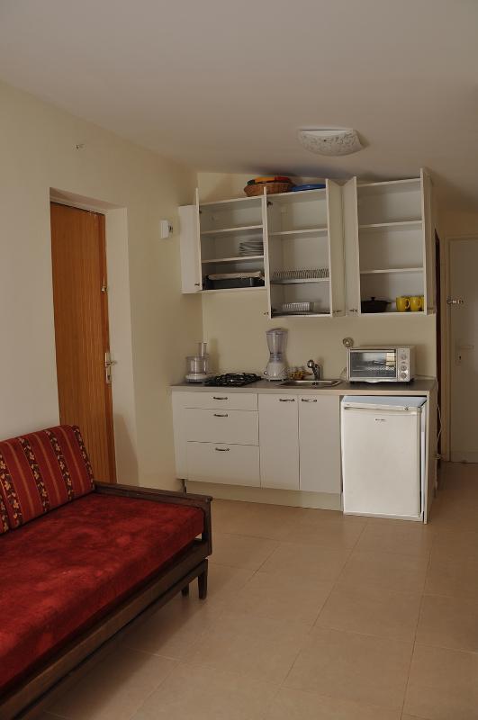 Kitchenette with open cupboard doors - Nice Studio Suite near Tel-Aviv, Airport & Sheba - Tel Aviv - rentals