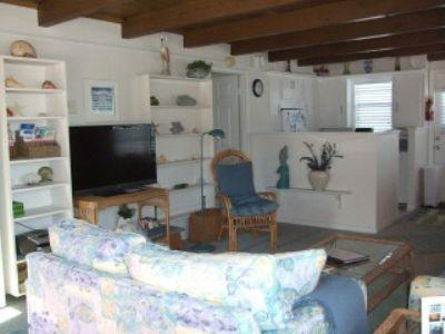 Living room with queen size sleeper sofa - Beautiful beach cottage! - Fort Myers Beach - rentals