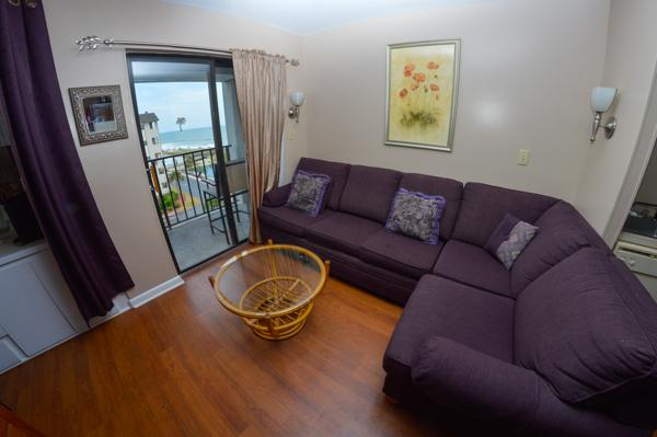 Living room with balcony access - STUDIO @ MB RESORT TOWER, POOLS/WIFI/GYM, RT405 - Myrtle Beach - rentals