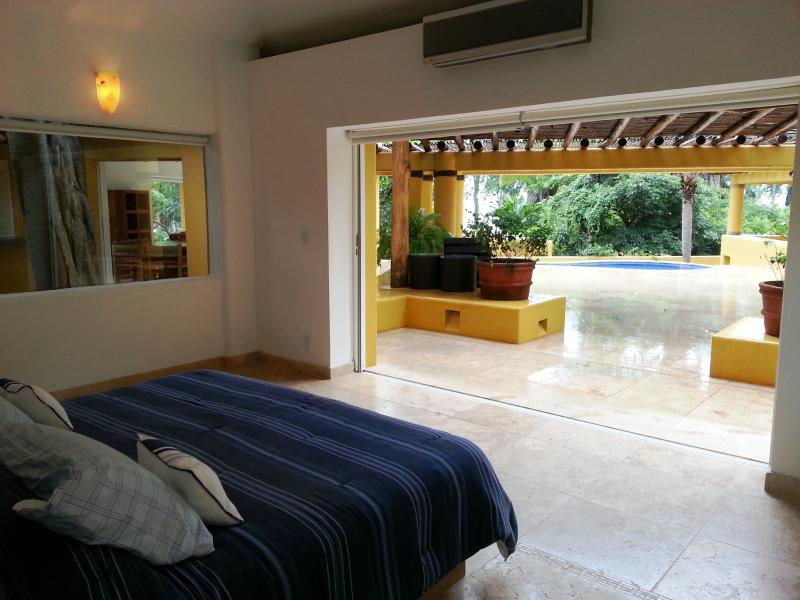 Bedroom 1 - view over pool towards ocean - Oceanview villa in gated paradise; R/T transport - Chacala - rentals
