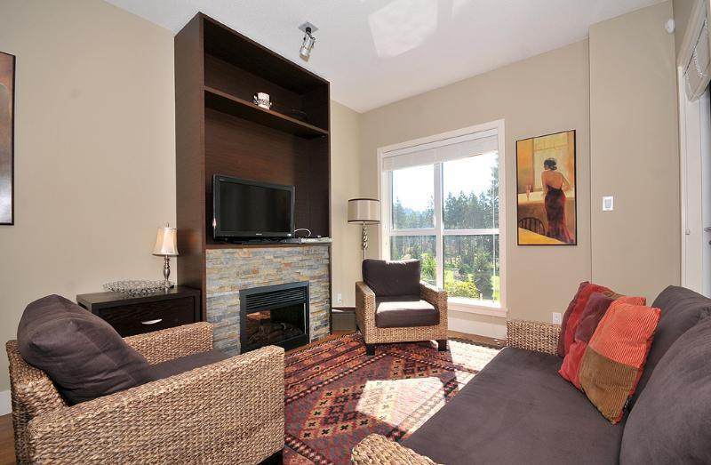 A comfortable living room spacious enough for the family. - Victoria Executive 1 Bedroom Condo With Fairway Views at Bear Mountain - Victoria - rentals