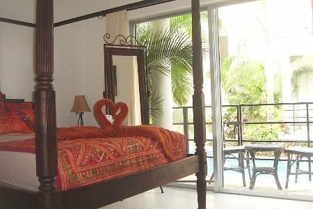 Queen Size - 4 poster bed in Master bedroom - Indonesian Hideaway - Two Bdr Condo - Playa del Carmen - rentals